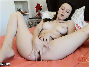 magnificent black-haired caresses her clittie