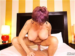 big-chested Russian GILF drizzles all over fuckpole
