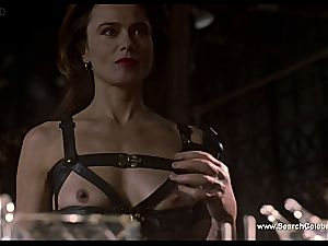 brown-haired Lena Olin in underwear showcases off her small funbags