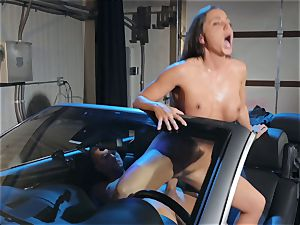 Abigail Mac spitting on a ginormous trunk