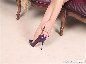 ash-blonde undresses off lingerie and solos in nylons and stilettos