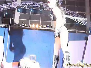 extraordinary needle fetish on public stage