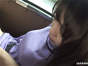 Eri blowing on a hard-on in the backseat of the car